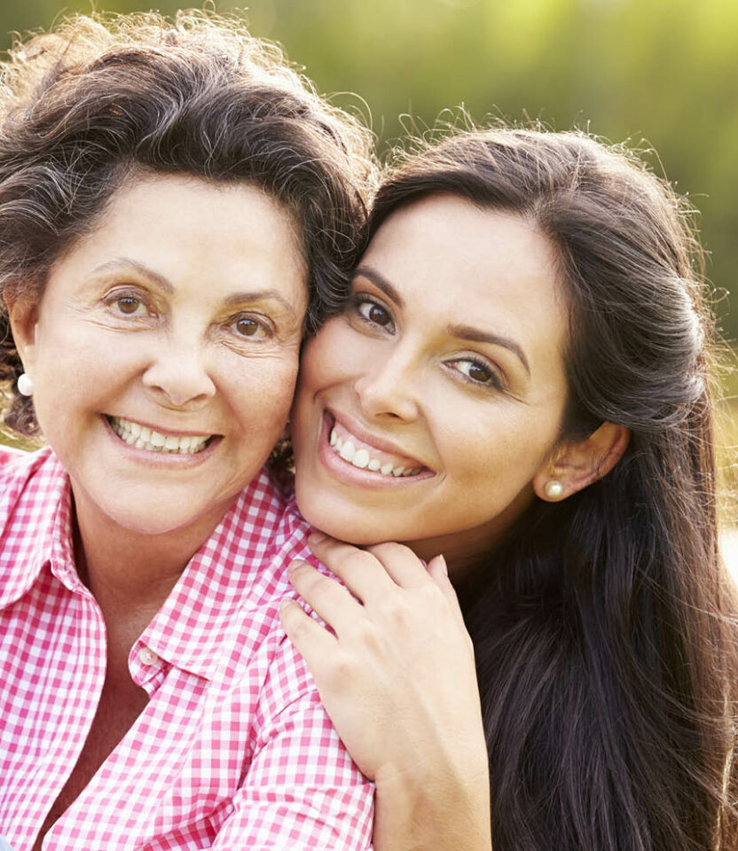 Senior woman and her daughter hug